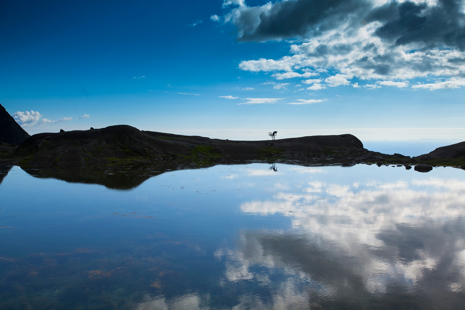 danny macaskill nose wheelie reflection photo