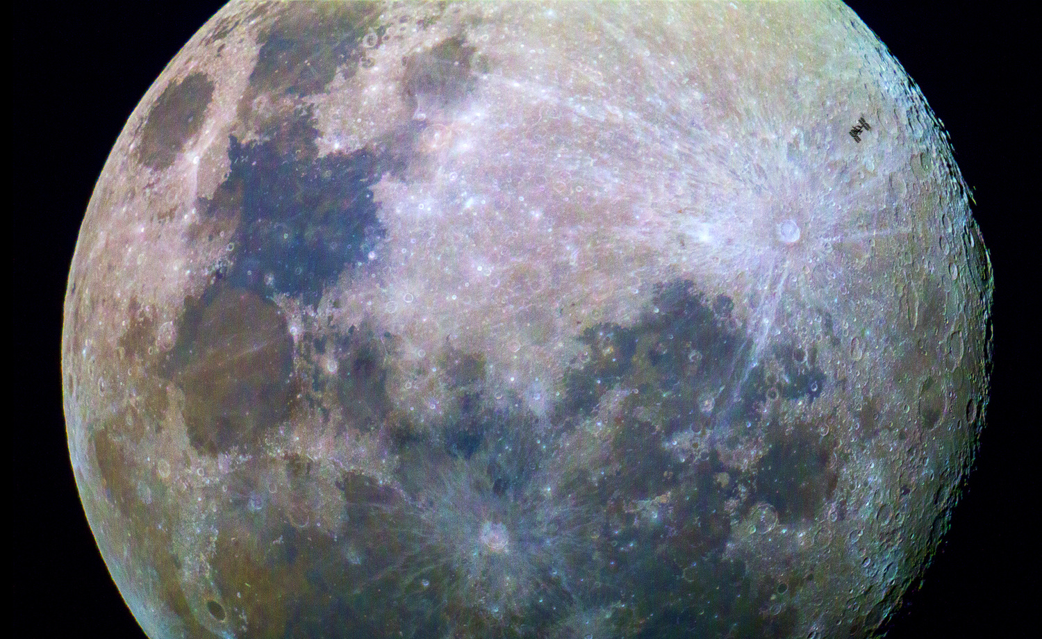 international space station crosses moon