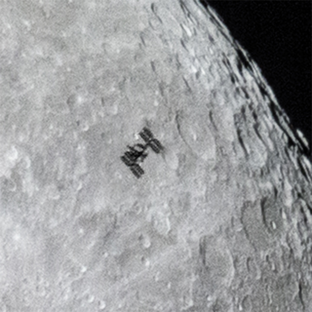 international space station flies in front of moon