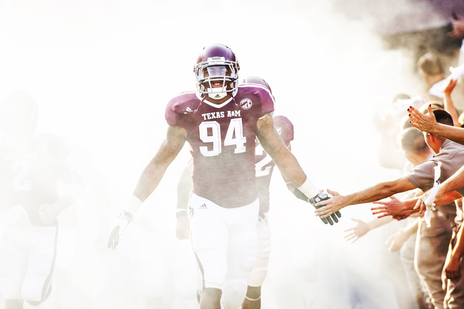 sports photography tips aggie football Damontre Moore