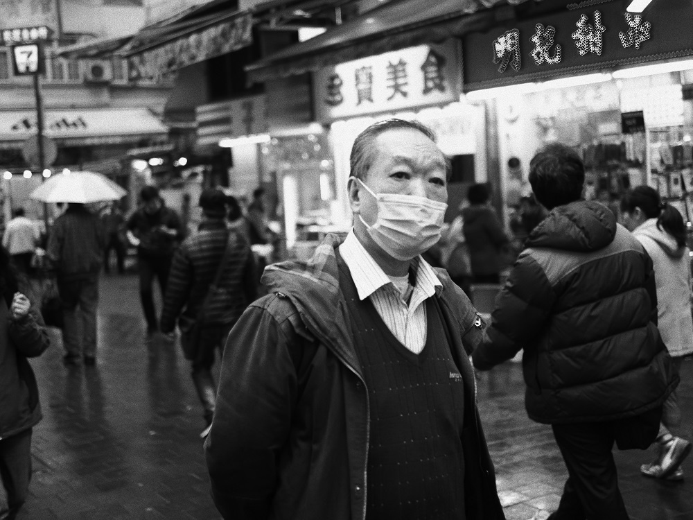 chinese man mask hong kong street photography
