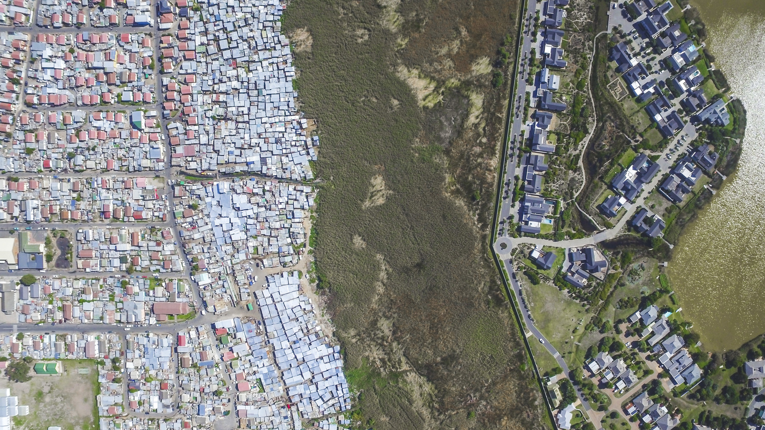 Masiphumelele on left, affluent suburbs on right