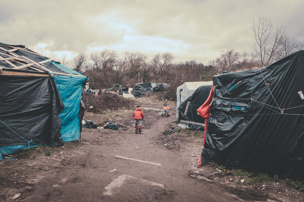 Faceless Forgotten A Photo Essay On The Refugee Crisis By  Children Play On The Wasteland Of The Jungle Of Calais Temporary Shelters  Made Of Wood And Plastic Have Been Their Home For The Past Two Months English Essay Websites also English Literature Essay Structure  How Does Technology Helps The Mass Media?