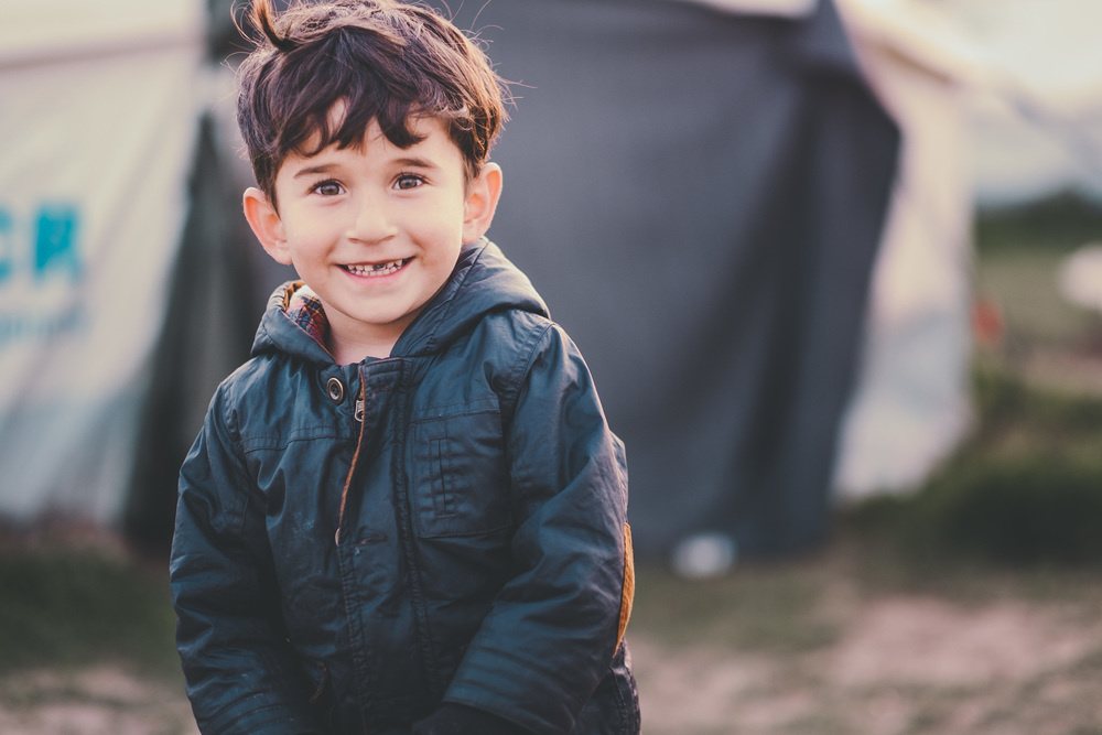 child refugee smile