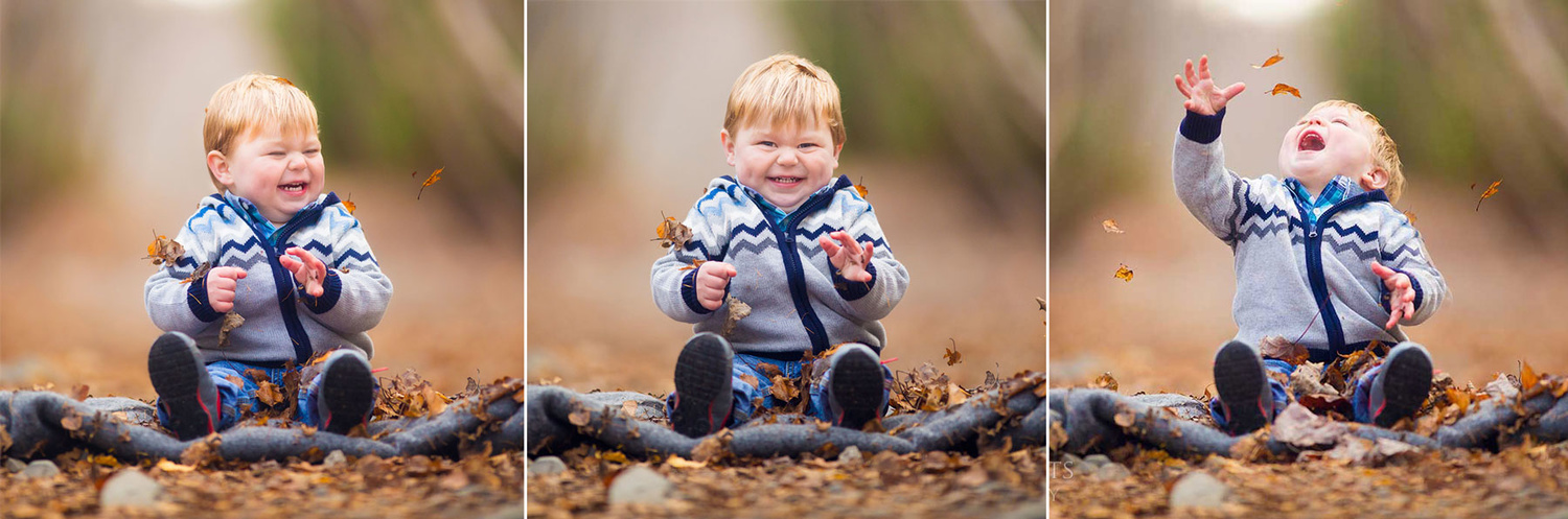 happy boy playing in autumn leaves