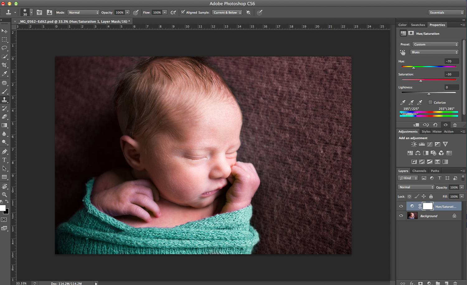 newborn sleeping in a teal wrap