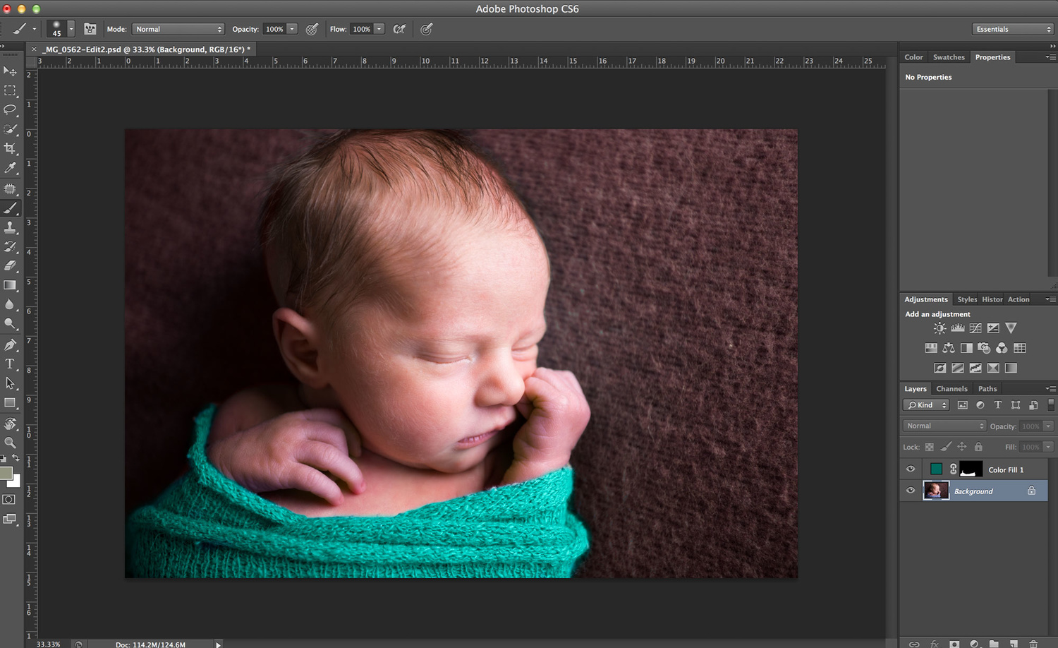 newborn sleeping in teal wrap