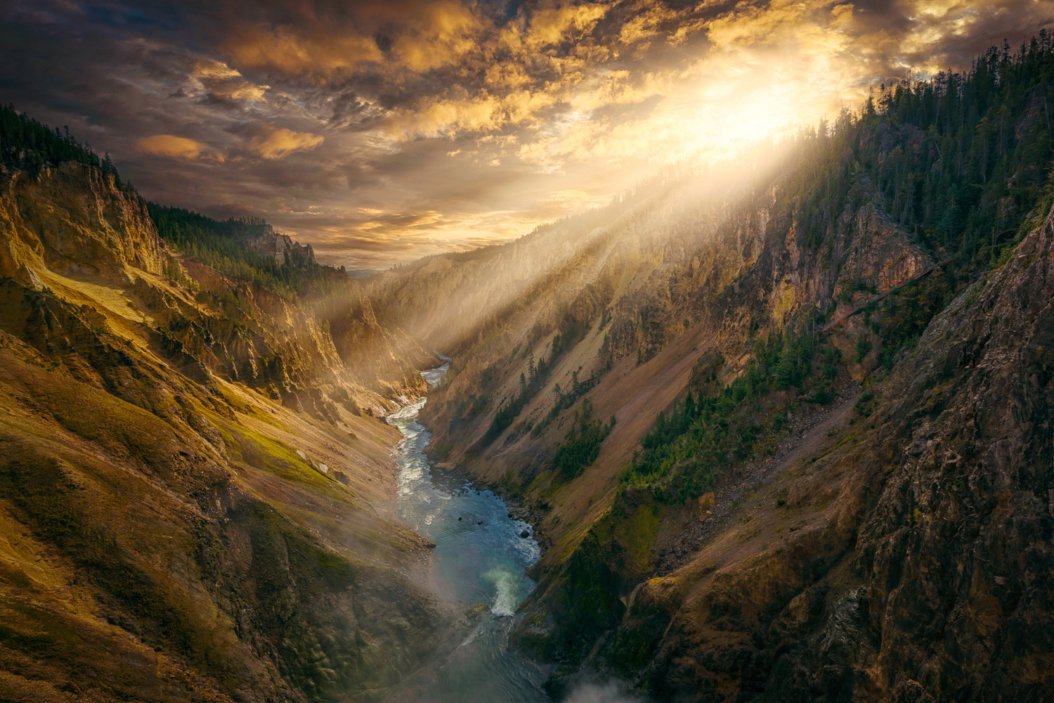 early morning shot of yellowstone canyon with a dramatic sky