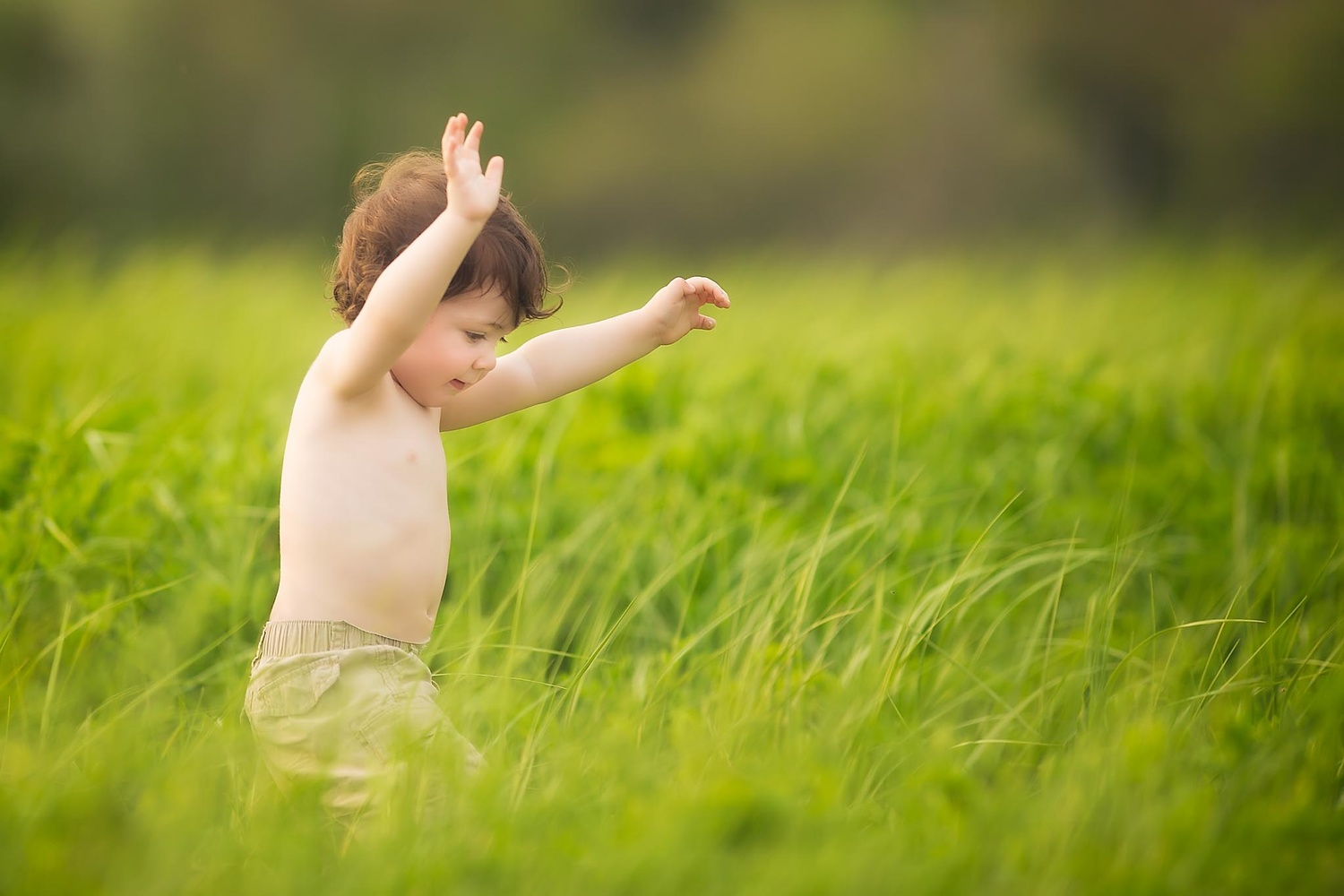boy running in tall grass