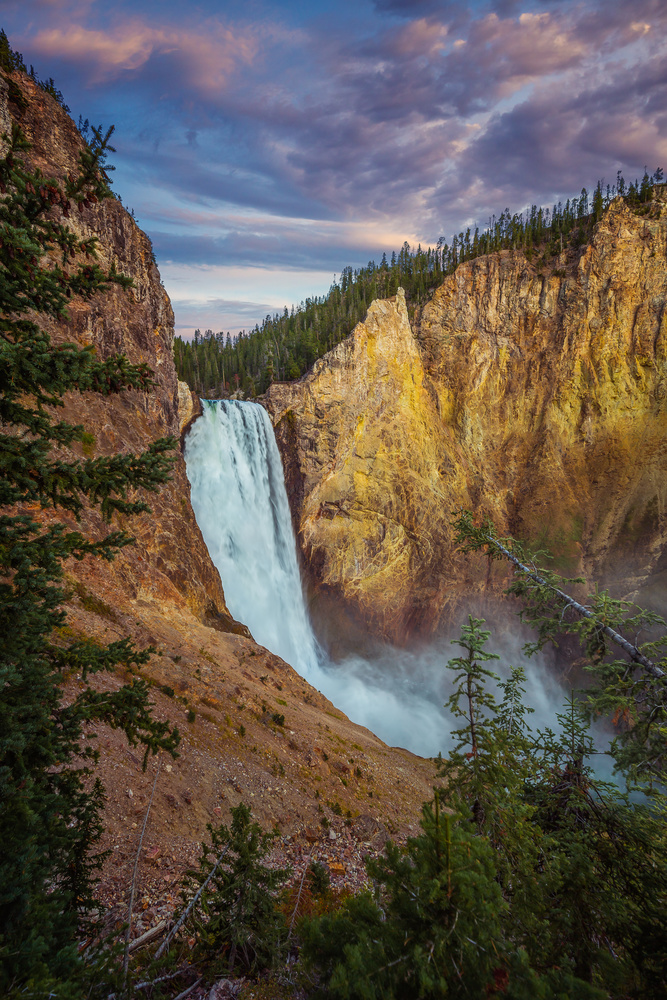 sunrise shot of lower falls in yellowstone national park