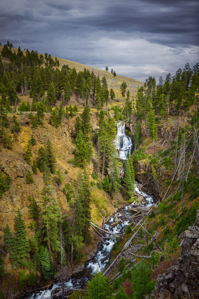 cloudy day shot of undine falls in yellowstone national park