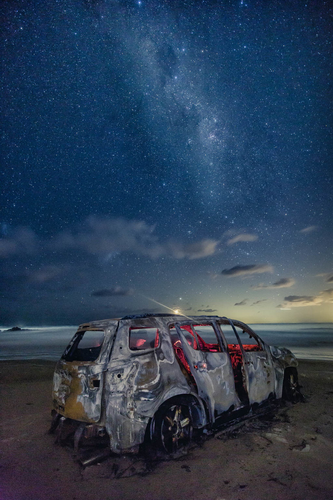 abandoned car, beach, milky way,  light painting