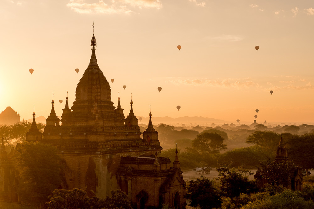 The Warm Glow Of Sunset Lighting Up Dust And Smoke On Plains Bagan In Myanmar Is One Famous Example This That Attracts Photographers From All