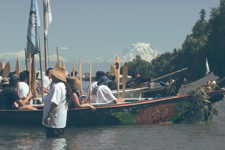 Tribal canoes landing in front or Mt Reiner, Washington State