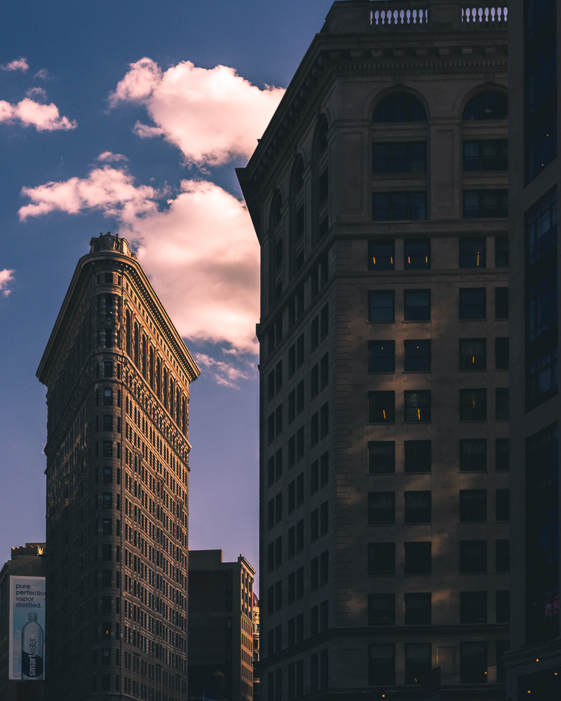 Sunset in New York City. Photograph of the Flatiron building in New York. Street Photography. Travel Photography.