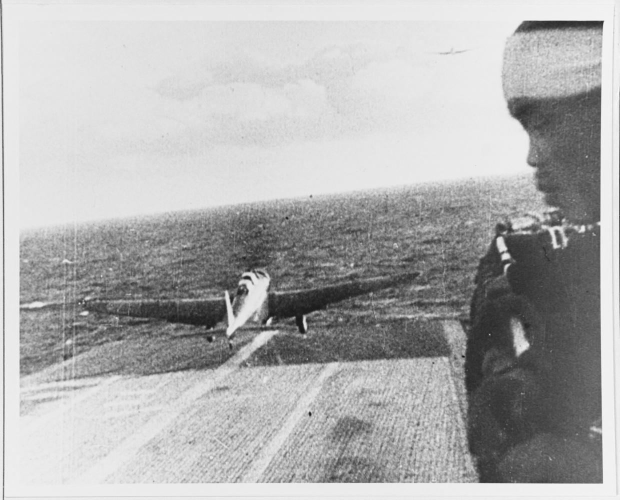A Japanese Navy Attack Plane taking off from an aircraft carrier on its way to Pearl Harbor on December 7, 1941. For some reason I liked the profile in the foreground of the Japanese soldier looking on.