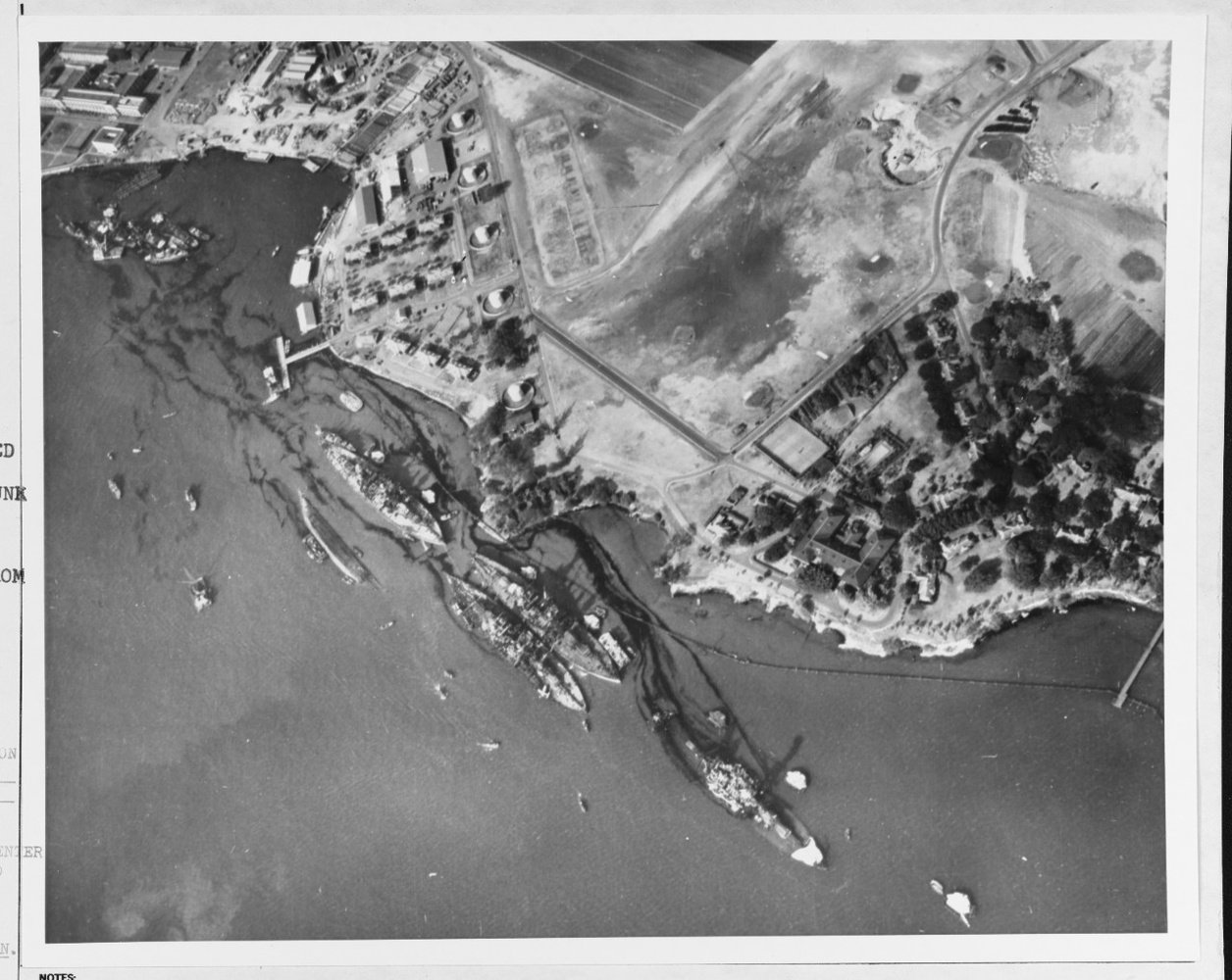 "This, to me, almost looked like an old drone shot. ""Aerial view of Battleship Row moorings on the southern side of Ford Island, 10 December 1941. ... Note dark oil streaks on the harbor surface, originating from the sunken battleships."""