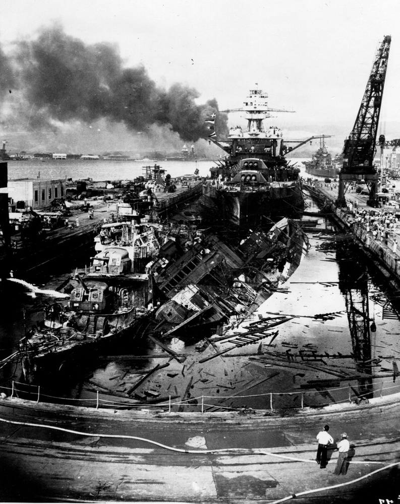 Here are the wrecked destroyers USS Downes and USS Cassin at the Pearl Harbor Navy Yard after the attacks were over. This image has been attributed to Navy Photographer's Mate Harold Fawcett