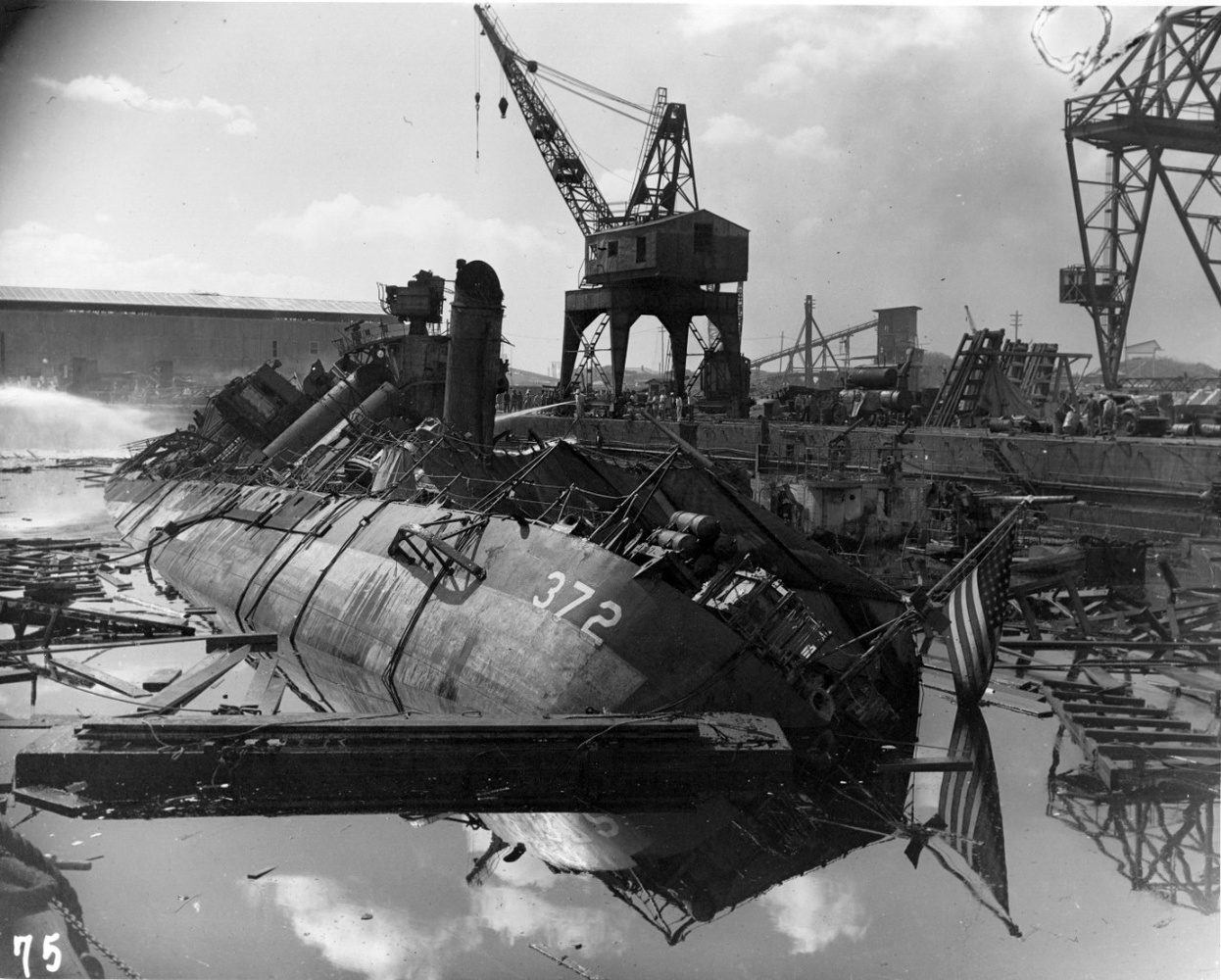 USS Cassin burned out and capsized against USS Downes after the attack. It's hard to imagine the time and effort required to clean up the wreckage from these massive ships.