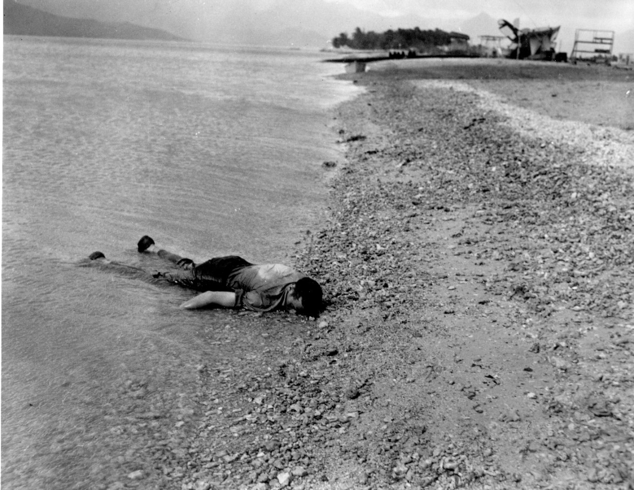 Sailor lies face down, killed during the air attack at the Naval Air Station in Kaneohe Bay.