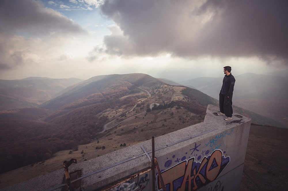 Thomas Couetdic atop Buzludzha, the former Communist Party headquarters of Bulgaria. Image by Andy Day