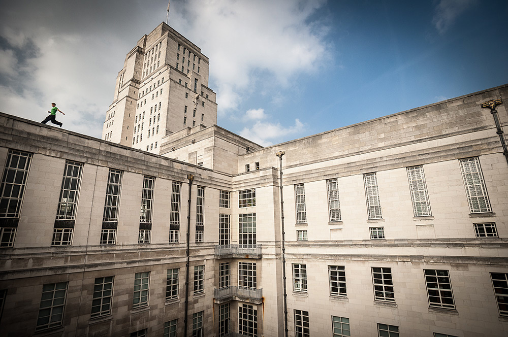 Flynn Disney exploring the rooftops of Senate House, London. Image by Andy Day.