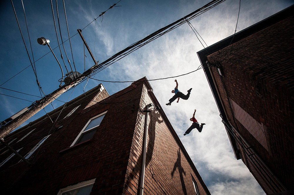 Chris Rowat and Chris Keighley jumping between rooftops in Quebec. Image by Andy Day.