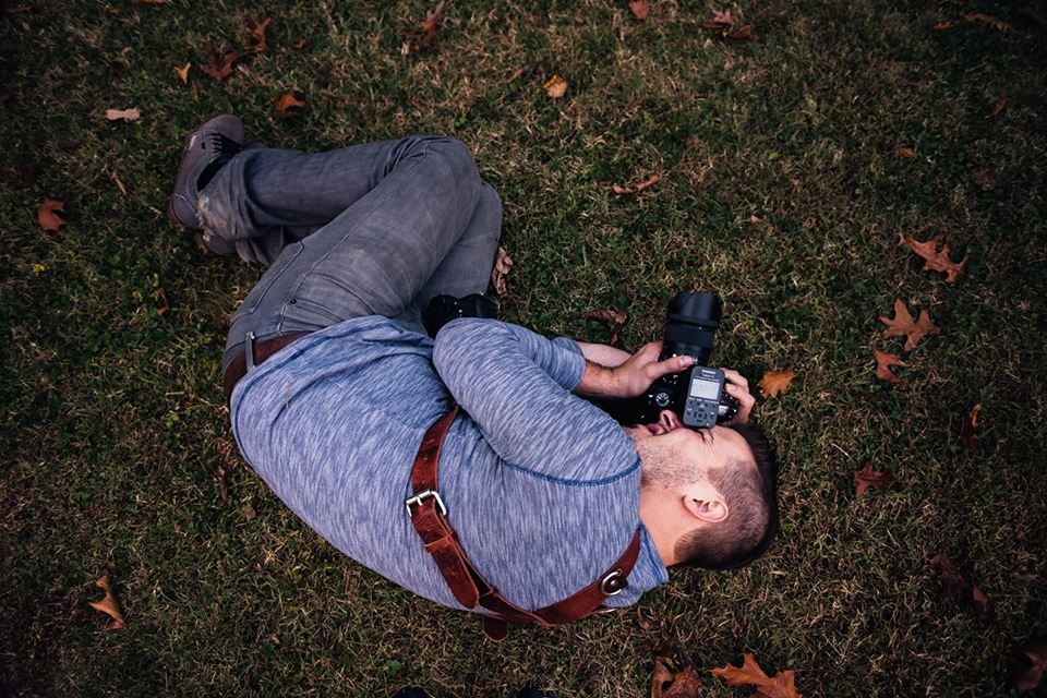 Writer Jason Vinson in the fetal position to get the perfect shot