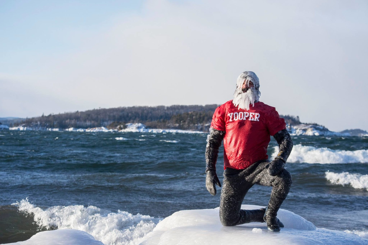 Surfer Dan poses with epic ice beard after surfing on Lake Superior Christmas Day