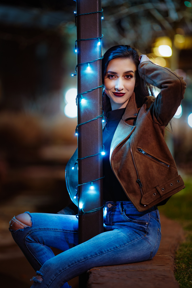 portrait of a girl at night with found light