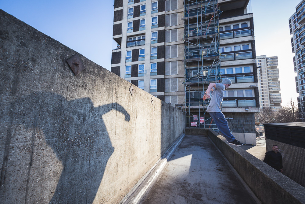 A parkour athlete jumping between walls. Andy Day.