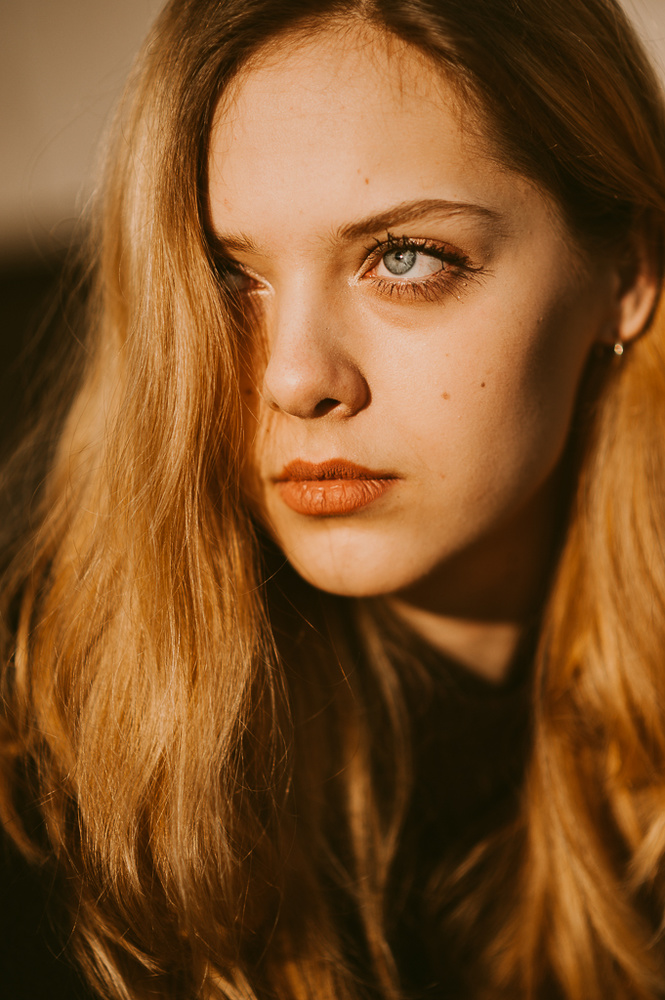 Close-up of a young blond woman.