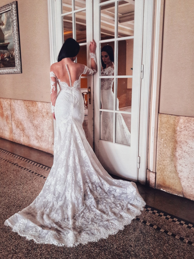 Bride with a wedding dress in a manor.