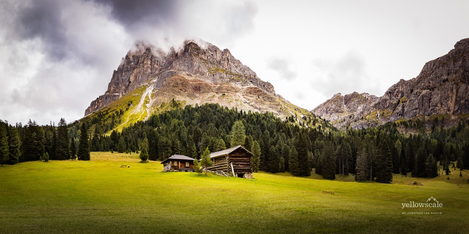 Cabins under the Sass de Putia in South Tyrol, Italy.
