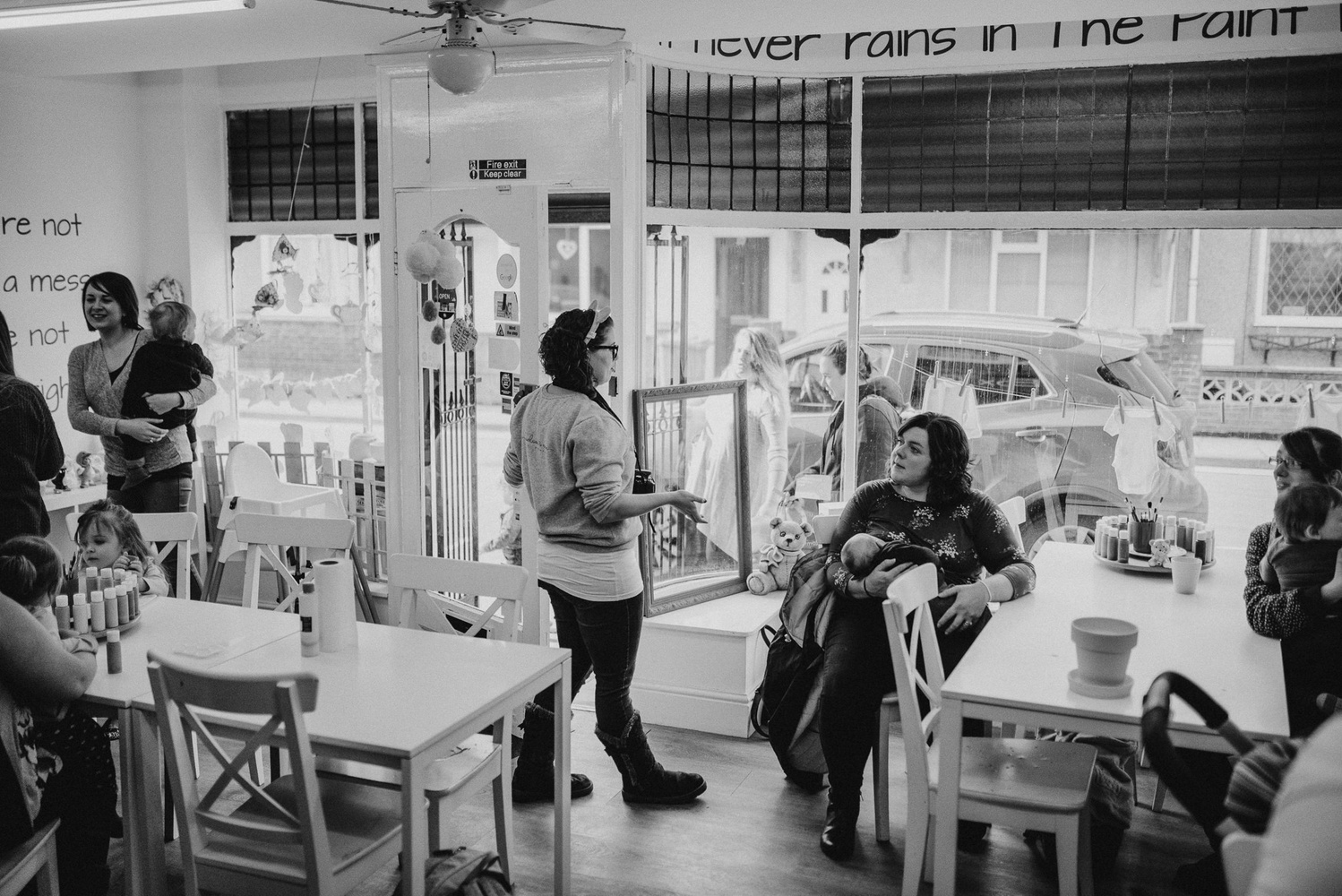 Mothers relaxing at a cafe.