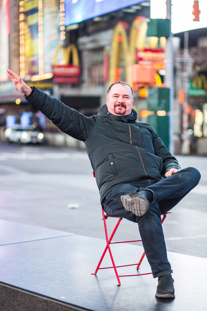 A man sat on a chair in Times Square