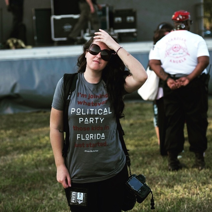 Photojournalist Emilee McGovern at a #NeverAgain rally. Photo by her father, Francis McGovern.