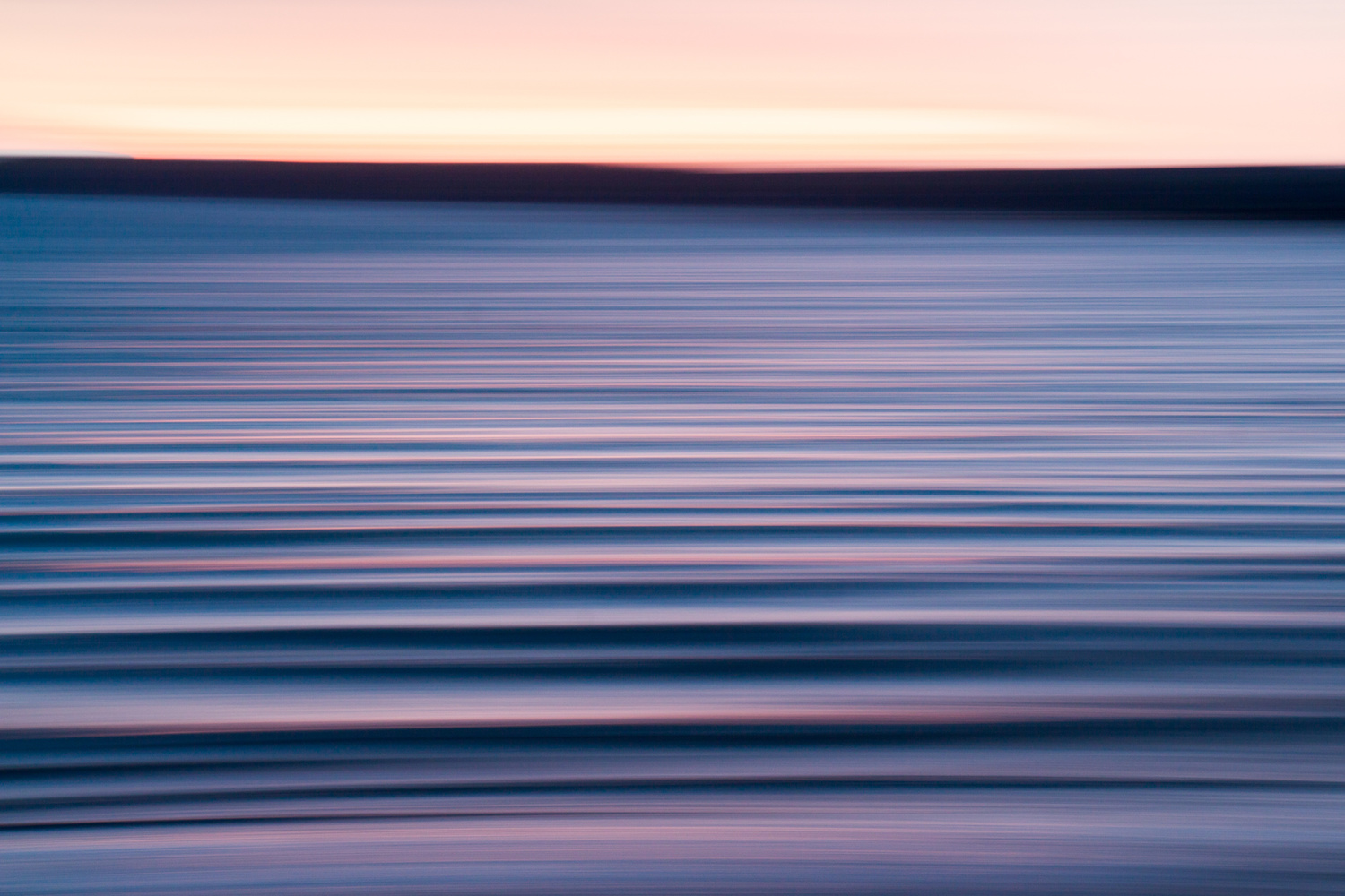 Abstract photograph of the sunset reflecting off of waves.