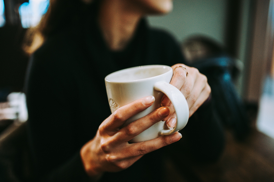 Girl holding a coffee cup.