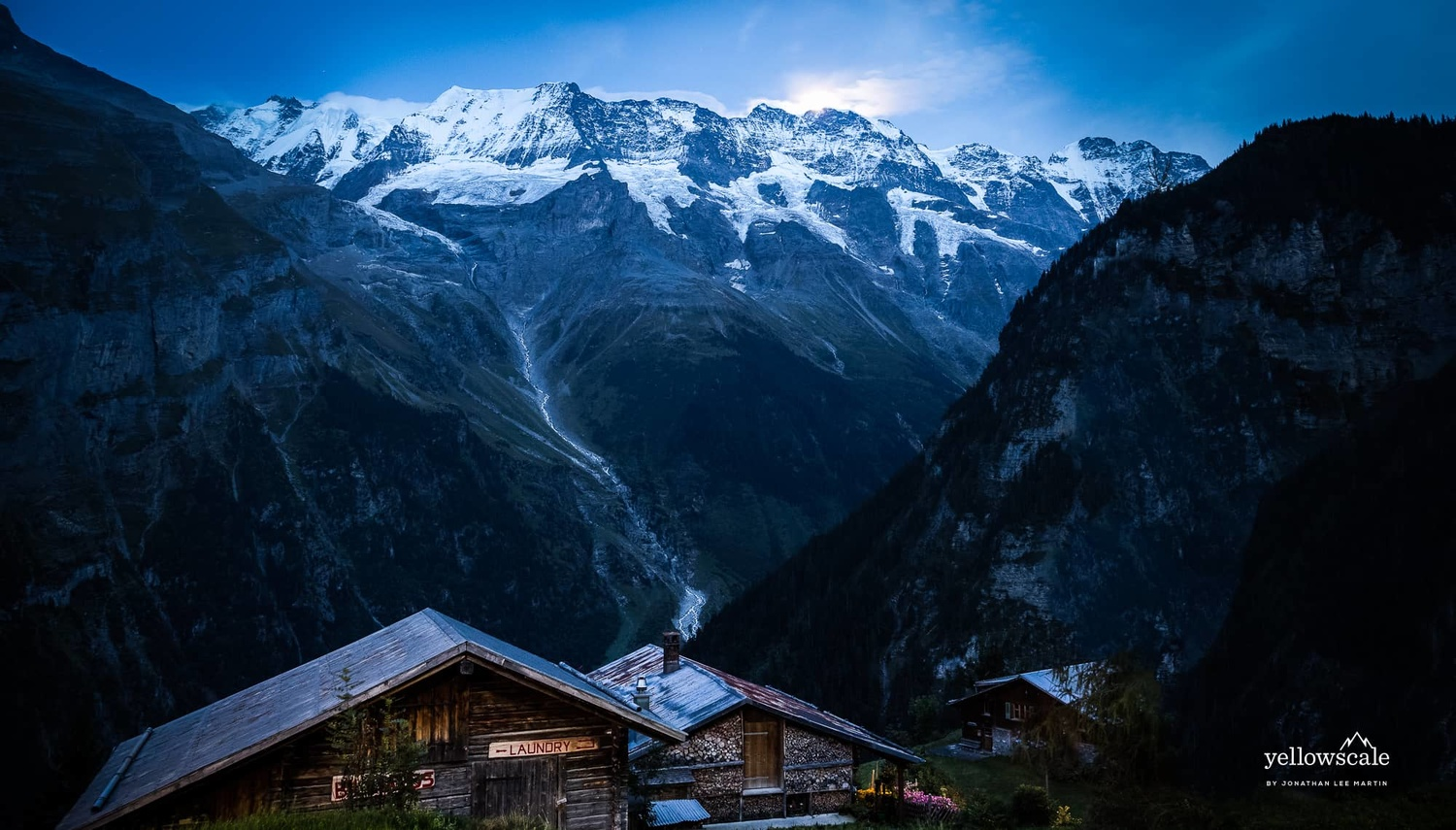 Moonlit Jungfrau over the Swiss hilltown of Gimmelwald.