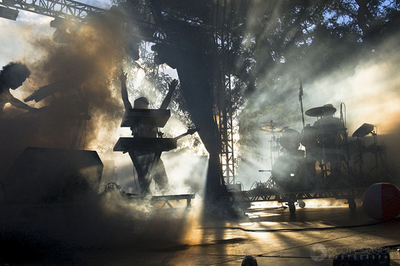 a photo of the band Future Rock playing on stage, with smoke and rays of light