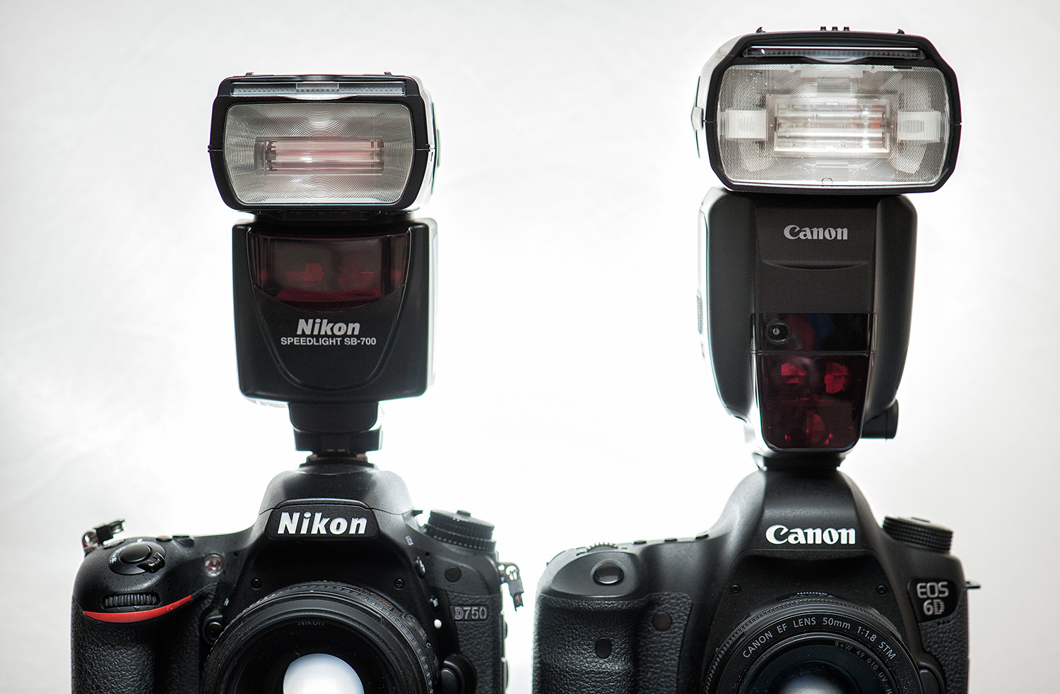 A size comparison between a Nikon SB-700 and the Canon 600EX-RT. The Canon 430EX III-RT is smaller still.