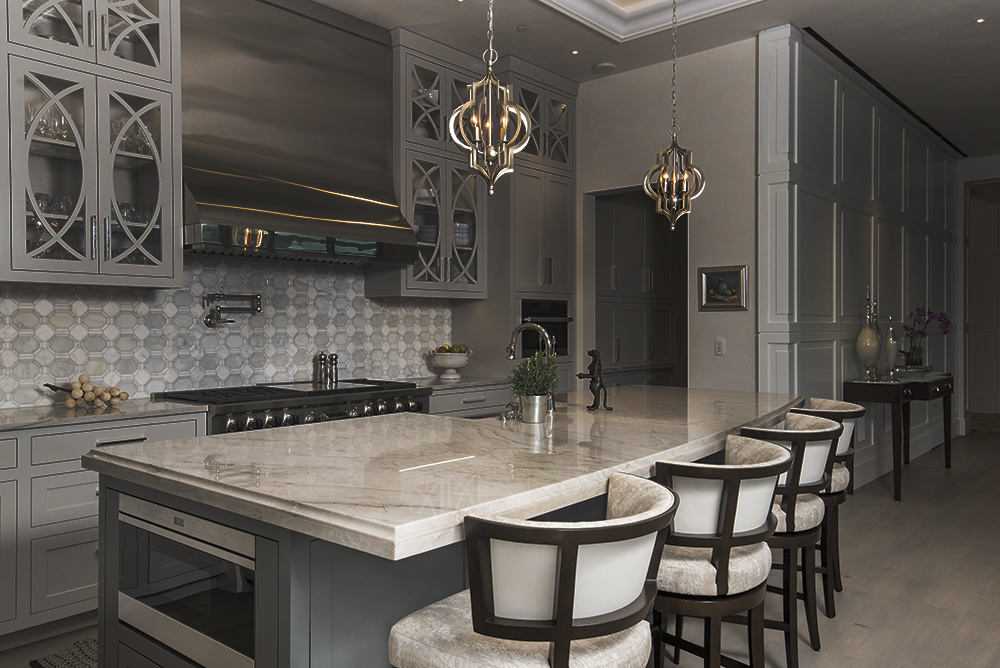 a behind-the-scenes interior image where a kitchen island is lit and nothing else