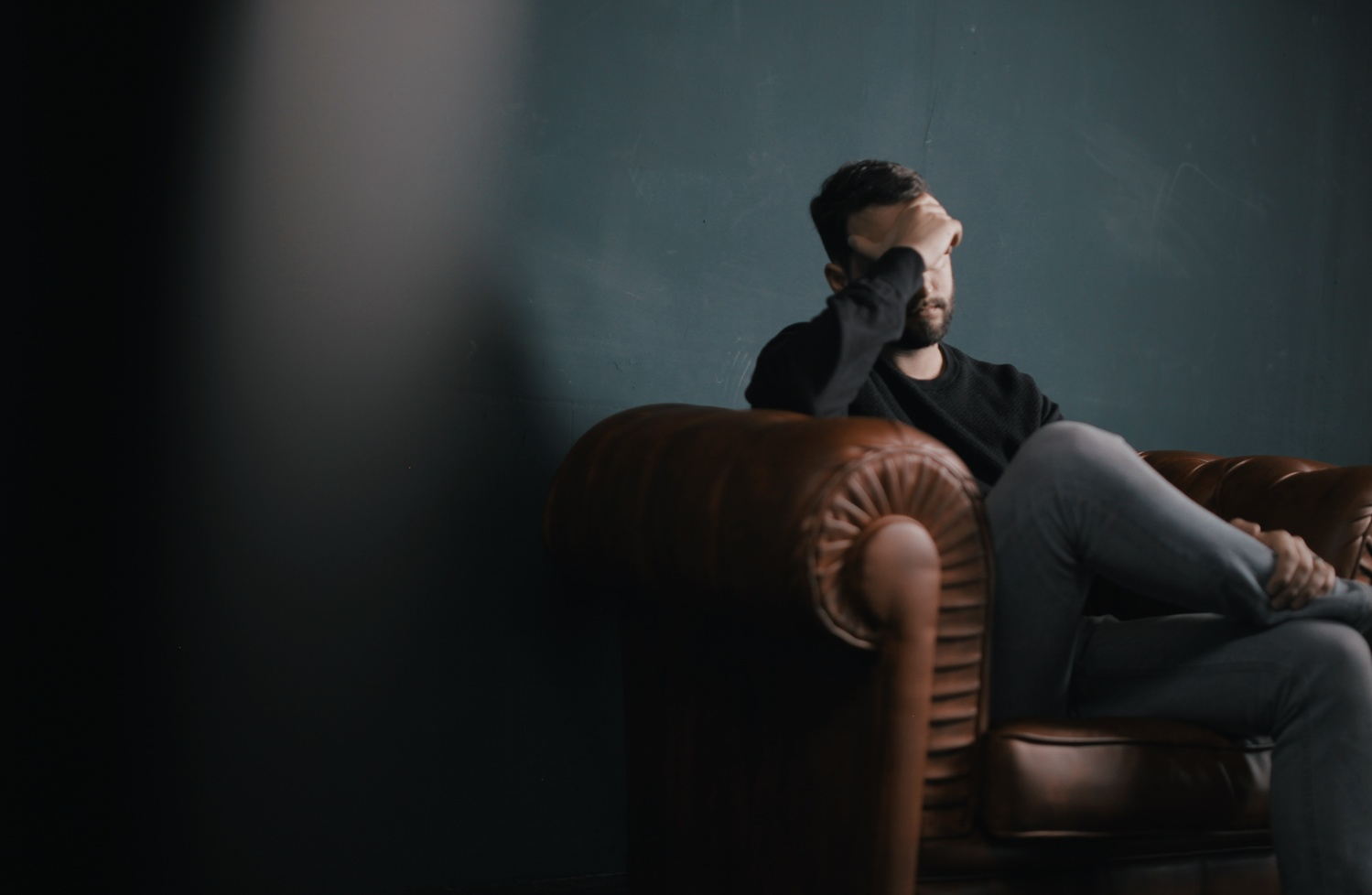 Man is stressed because of Instagram addiction