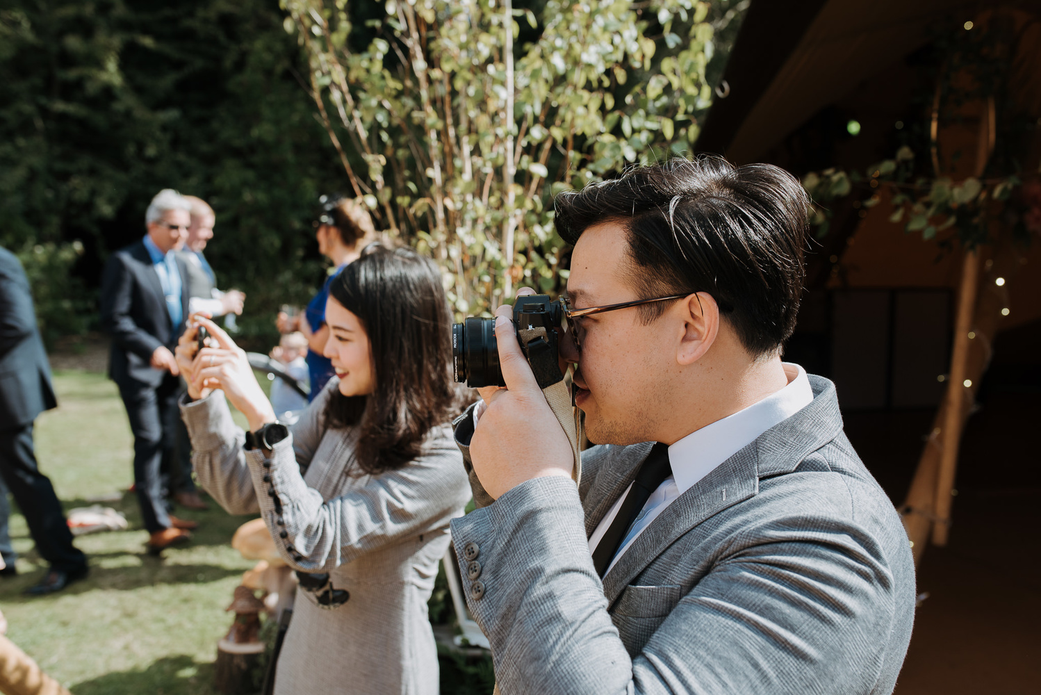Wedding guests taking photographs