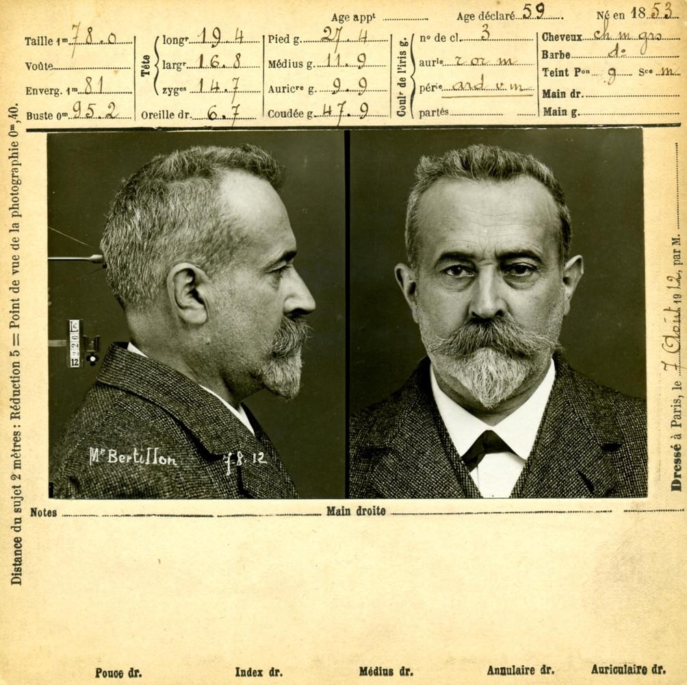 a creative commons historial photo of a mugshot by famous photographer Alphone Bertillon.