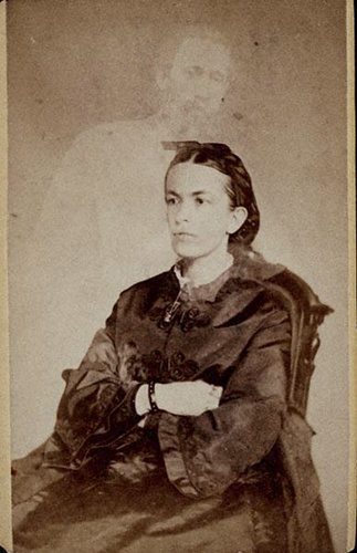 A William Mumler portrait with a ghostly man standing behind the female subject.