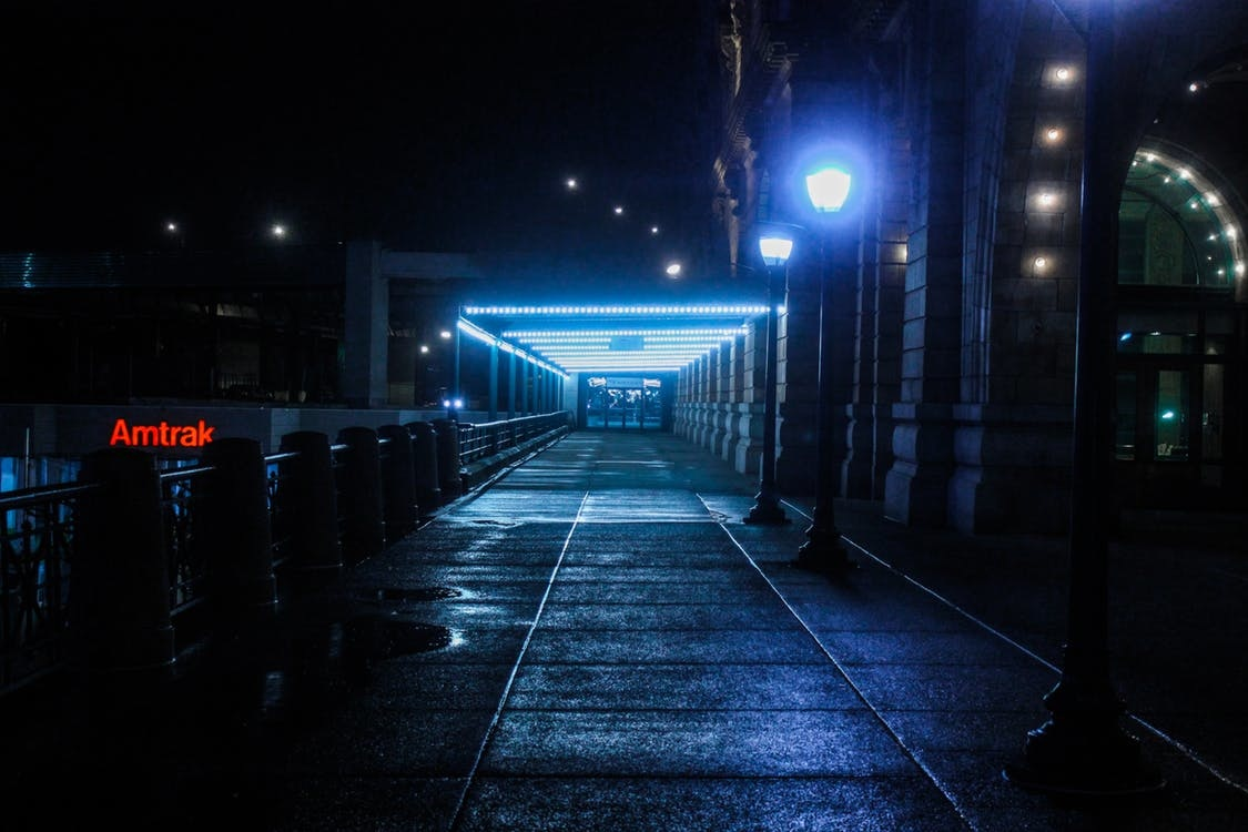 a low-key image of the entrance to an Amtrak station at night
