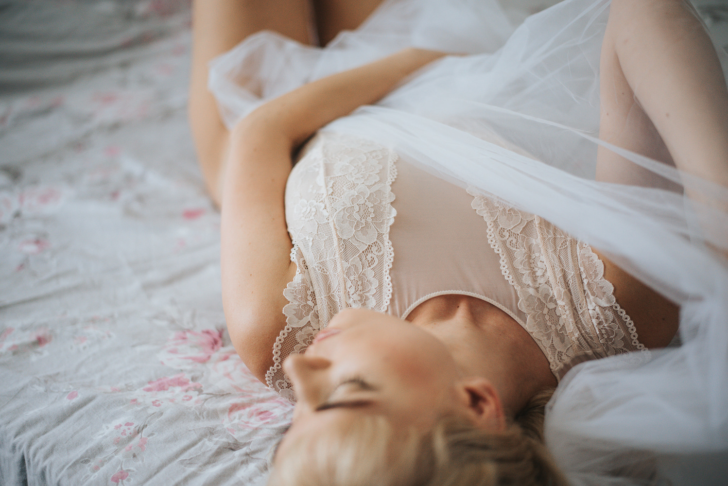 A young blond woman laid down on the bed.