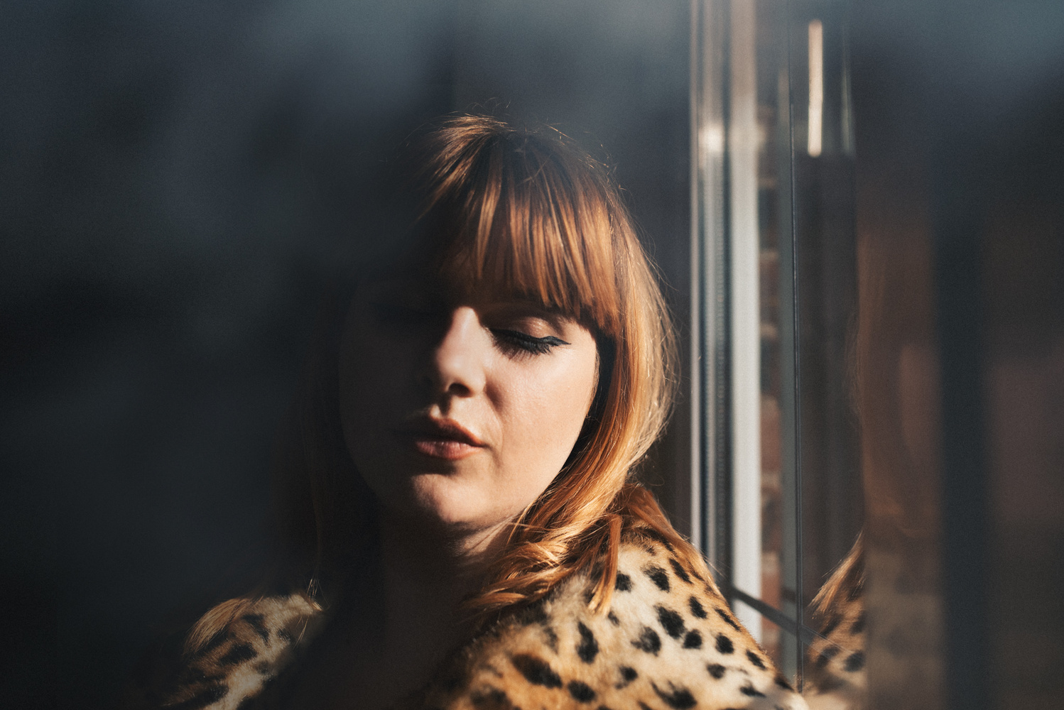A ginger woman in a leopard print coat.